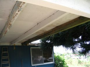 E. Cracked beams are replaced with new pressure treated beams.